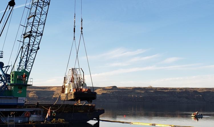 Tug Nova rising from water