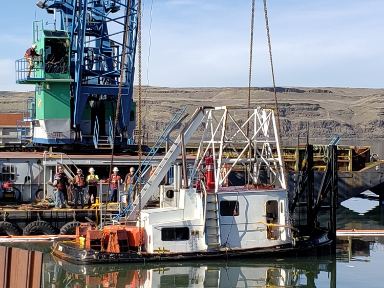 Tug Nova partially submerged